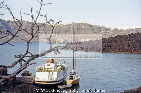 boats moored volcanic island nea kameni near santorini greece greek european travel aegean sea cyclades atlantis minoan caldera volcano pumice basalt lava europe