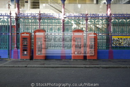 uk traditional phone boxes row old smithfield meat market british telecom telecommunications telephone media communications box red london city cockney england english great britain united kingdom