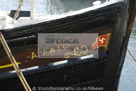 old fishing boat avail manx flag harbour harbor uk coastline coastal environmental bow wooden fish traditional isle man england english great britain united kingdom british