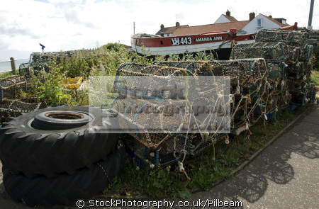 fishing boats lobster pots overstrand near cromer norfolk british beaches coastal coastline shoreline uk environmental fish crabs seaside coast sea food england english great britain united kingdom