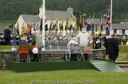 british legion flags disabled people tynwald parade isle man elderly aged old senior men adult males masculine manlike manly manful virile mannish persons manx standard bearers marching england english great britain united kingdom