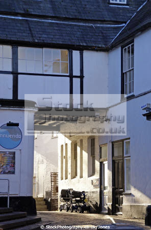 sunlight slanting passageway crown court yard evesham half timbered buildings historical uk history british architecture architectural hairdressers nightclub solicitors lawyer arch worcestershire england english great britain united kingdom