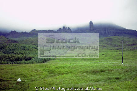 isle skye old man storr appears mist. rock formations geology geological science misc. scottish scotland celtic tower feature formation weathering cloud eilean sgitheanach highlands islands scotch scots escocia schottland great britain united kingdom british