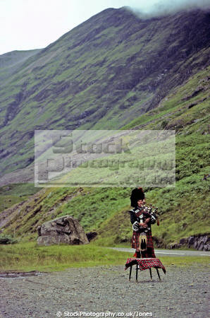 lone piper glencoe scotland. countryside rural environmental uk scotland scottish celtic bagpipes highlands islands scotch scots escocia schottland great britain united kingdom british