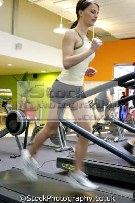 woman running machine gym gymnasium health clubs exercise physical athletic aerobic anaerobic fitness people persons