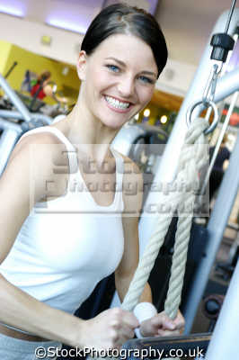 smiling woman working gym gymnasium health clubs exercise physical athletic aerobic anaerobic fitness people persons