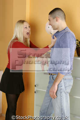 young couple home play fighting couples arguing domestic disputes strife confrontation husband wife boyfriend girlfriend spouse families family kin kinfolk tribe generations geneaology people persons fake