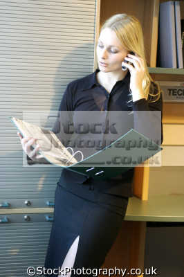businesswoman office mobile phone consulting ring binder phones cell-phones cell phones cellphones males masculine manlike manly manful virile mannish people persons