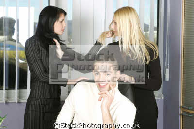competitive women having catfight office man oblivious business