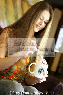 woman scopping froth starbucks coffee people drinking eating nutrition human activities persons latte