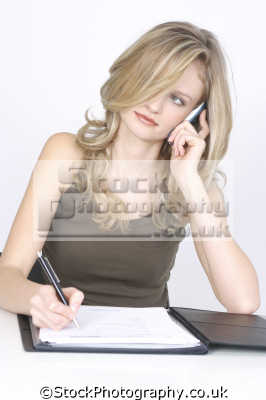 businesswoman writing having phone conversation mobile phones cell-phones cell phones cellphones males masculine manlike manly manful virile mannish people persons