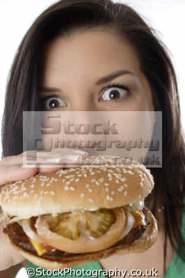 biting burger junk food unhealthy nutritional balanced diet eating nutrition human activities people persons beefburger