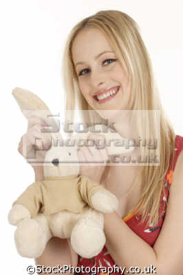 smiling blonde cuddley toy smiles facial expression pleasure amusement faces visage people persons