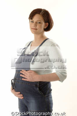 pregnant woman dungarees pregnancy childbirth graviditas obstetric gestation women female females feminine womanlike womanly womanish effeminate ladylike people persons