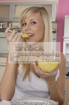 eating pineapple people mastication nutrition ingestion digestion meals food human activities persons