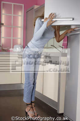 looking fridge cooking cuisine housework domestic chores working people persons