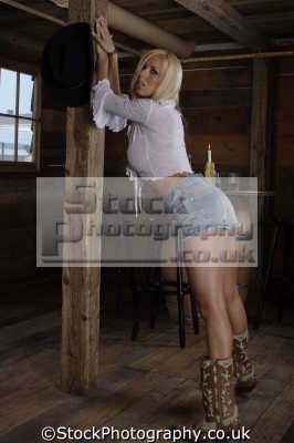 cowgirl sexy pose cut-off cut off cutoff jeans cowboy boots female sexuality sexually attractive attraction women woman females feminine womanlike womanly womanish effeminate ladylike people persons