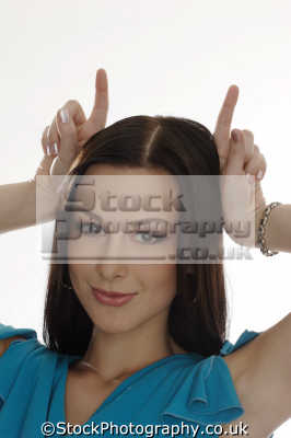 devil hand gestures non-verbal non verbal nonverbal communication body language people persons horns naughty