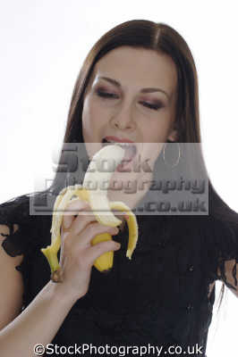 woman biting banana healthy eating nutrition balanced diet human activities people persons phallic felatio