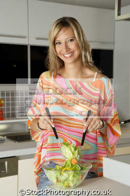 tossing salad women cooking cookery cuisine meals housework domestic chores working people persons