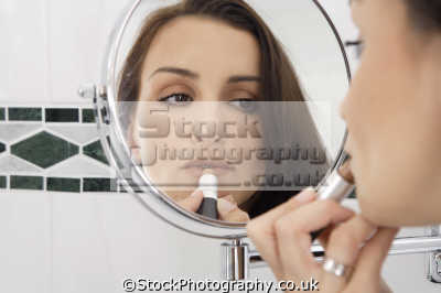 woman applying lipstick makeup cosmetics make-up make up makeup fashion haute couture chic designer people persons