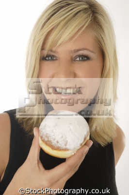 doughnut people eating mastication nutrition ingestion digestion meals food human activities persons bun confectionary confectionery
