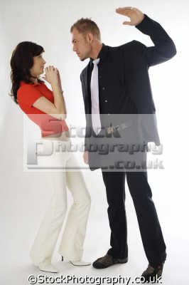 man hitting woman couples arguing domestic disputes strife confrontation husband wife boyfriend girlfriend spouse families family kin kinfolk tribe generations geneaology people persons violence aggression