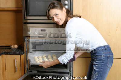 baking biscuits women cooking cookery cuisine meals housework domestic chores working people persons