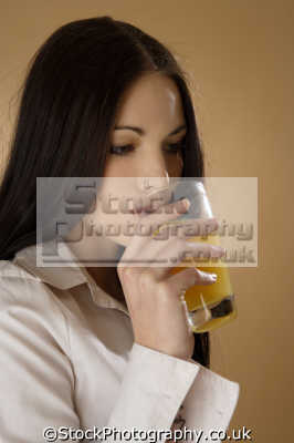 sipping orange juice people drinking eating nutrition human activities persons