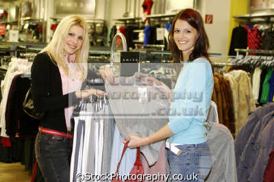 Two Friends Shopping In A Clothing Store Stock Photo | Getty Images