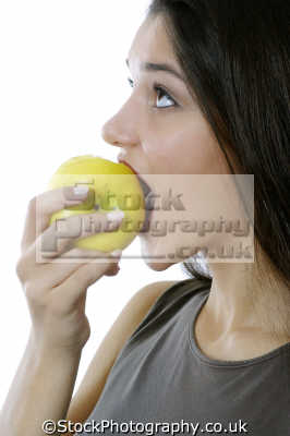 biting apple healthy eating nutrition balanced diet human activities people persons fruit