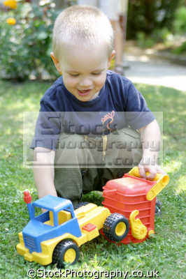 toddler playing truck boys male child males masculine manlike manly manful virile mannish people persons