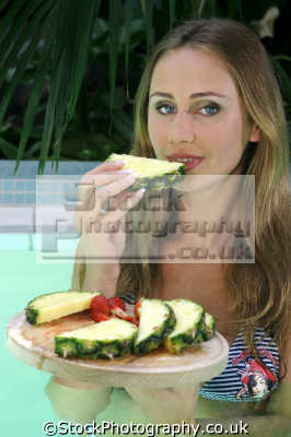 eating pineapple healthy nutrition balanced diet human activities people persons fruit platter