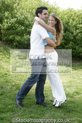 hugging park couples husband wife boyfriend girlfriend spouse families family kin kinfolk tribe generations geneaology people persons