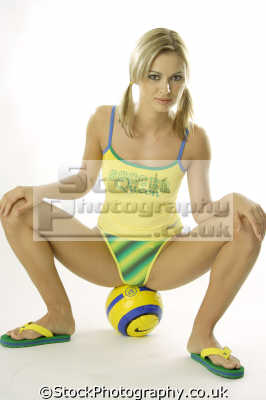 soccer ball sporty women woman female females feminine womanlike womanly womanish effeminate ladylike people persons ponytails anorexia size zero football