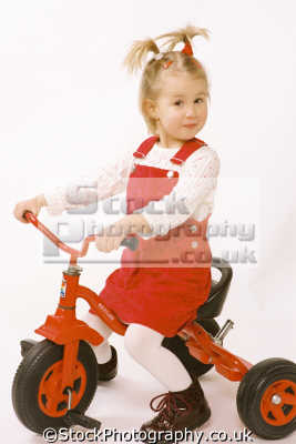 girl pony tails trike girls female children kids juveniles infants females feminine womanlike womanly womanish effeminate ladylike people persons