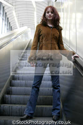 escalator women woman female females feminine womanlike womanly womanish effeminate ladylike people persons