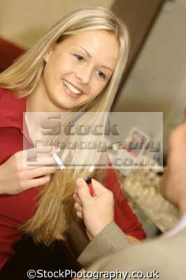 young woman lighting cigarette people smoking tobacco anti social drug health addiction nicotine lung cancer emphysema cardiovascular disease smokers human activities persons