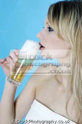 frothy head beer drinking alchohol people eating nutrition human activities persons