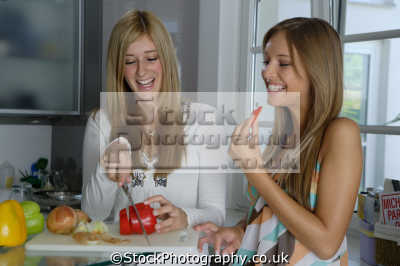 chatting food preparation women cooking cookery cuisine meals housework domestic chores working people persons red pepper