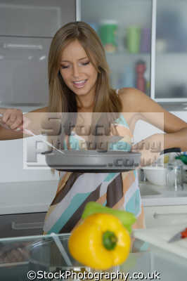 frying pan women cooking cookery cuisine meals housework domestic chores working people persons