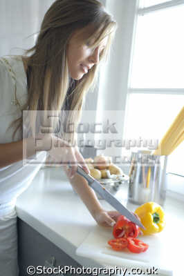 chopping peppers women cooking cookery cuisine meals housework domestic chores working people persons