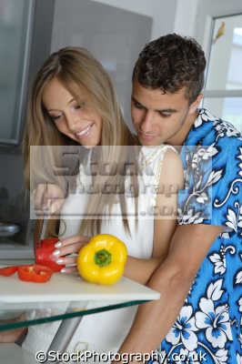 couple intimate cooking cuisine housework domestic chores working people persons