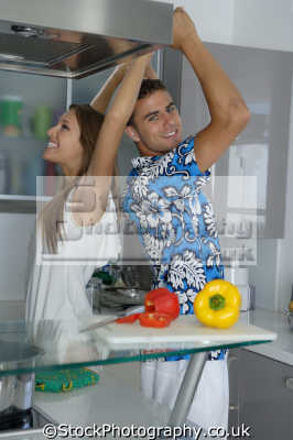 couple happy kitchen cooking cuisine housework domestic chores working people persons