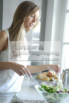 tossing salad women cooking cookery cuisine meals housework domestic chores working people persons lettuce