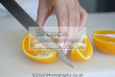 slicing orange cooking cuisine housework domestic chores working people persons