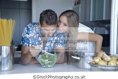 couple smooching kitche cooking cuisine housework domestic chores working people persons