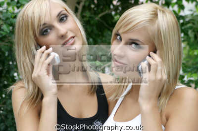 twin sisters mobile phones cell-phones cell phones cellphones males masculine manlike manly manful virile mannish people persons blonde