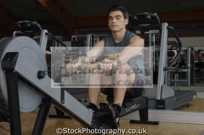 rowing machine gym gymnasium health clubs exercise physical athletic aerobic anaerobic fitness people persons