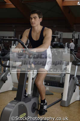 cycling machine gym gymnasium health clubs exercise physical athletic aerobic anaerobic fitness people persons